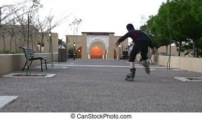 Boys practicing skate in a park