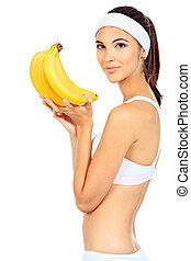 banana - Portrait of a beautiful young woman with bananas...