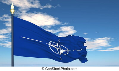 Flag Of NATO on the background of the sky and flying clouds.