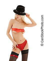 playful girl in red belt and black hat - picture of playful...