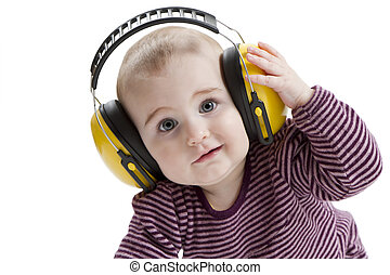 young child with ear protector - young child with yellow ear...