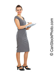 Female employee writing in notebook