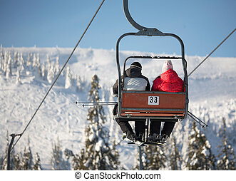 Ski lift carrying skiers