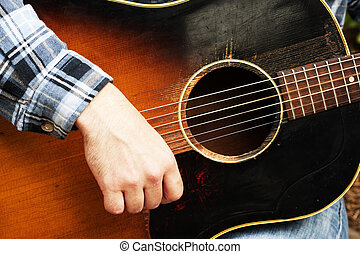 Acoustic guitarist - A guy strumming his 6 string acoustic...