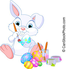 Bunny Painting Easter Egg - Cute Easter Bunny painting an...