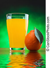 orange juice in a glass on a table