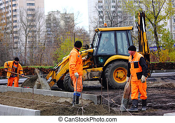 Road workers The asphalt - Road workers laid asphalt in the...