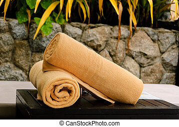 Rolled up bath towels - rolled up bath towels placed on the...