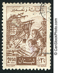 Family among Ruins - LEBANON - CIRCA 1956: stamp printed by...