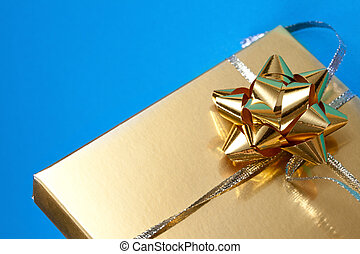 Decorated gift box on the blue background