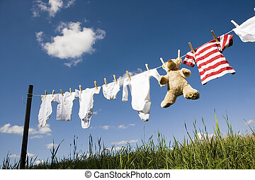 Baby clothing on a clothesline - Baby Clothing and a...