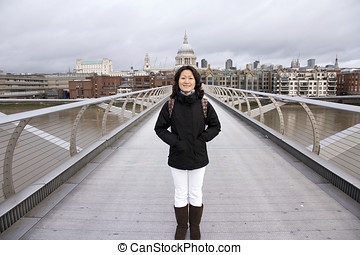 Smiling East Asian Woman Visiting London - Smiling East...