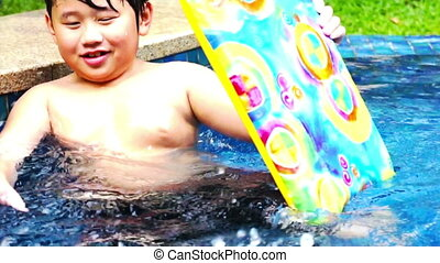 Water Gun Boy - Asian boy playing in the swimming pool