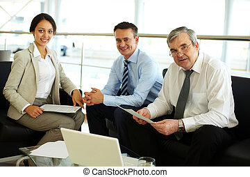 Working together - Business team working together at a new...
