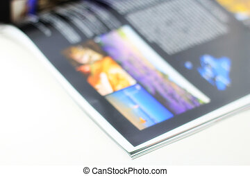 Open one - Open magazine on the table. Shallow DOF.
