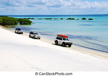 4x4 island adventure - 3 4-wheel drives travel along the...