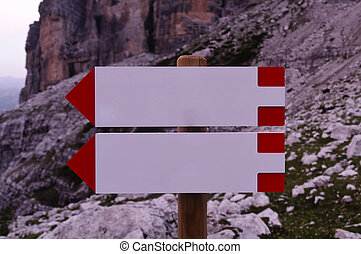 Blank direction signs in the mountains