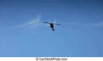 Helicopter flaying on blue sky