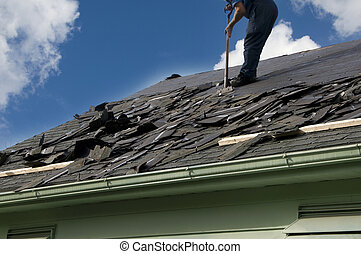 Shingles - Removing old shingles to prepare a roof for a new...