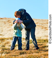Family make photo on autumn mountain plateau - Family mother...