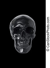 Black skull isolated on black background