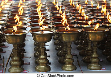 Candles burning in Buddhist temple