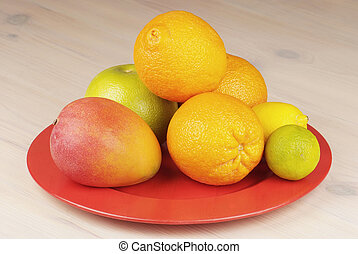 tropical fruit in a plate on the table