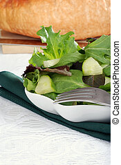 Mixed salad focus on fork