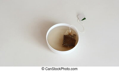 A cup of brewed black tea in a bag. HD H.264