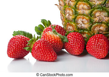 Isolated fruits - Strawberries and pineapple on white...