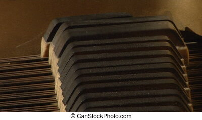 piano damper cu - This is a close shot of the inside of a...