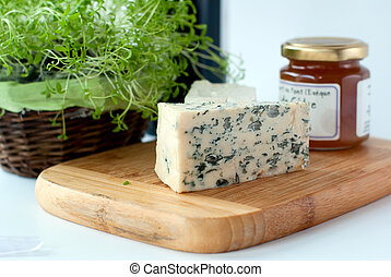Blue cheese and feta - Wooden board with slices of blue...