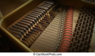 Piano strings - This is a close up shot of the inner...