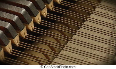 Piano strings zoom - This is a close up shot of the inner...