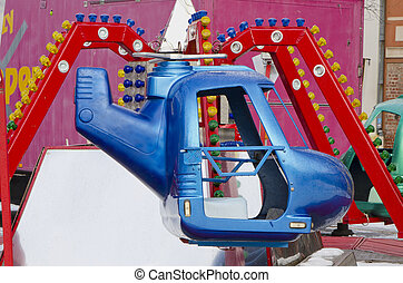 amusement park rides colorful carousel spin helicopter -...