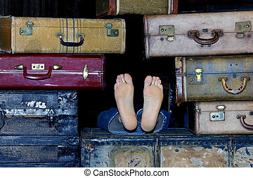 Feet Protruding from Suitcases - Mans feet sticking out of a...
