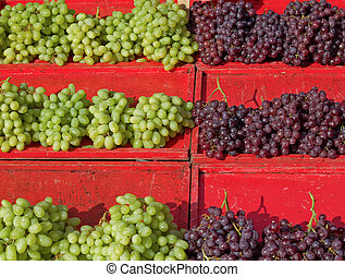 Sunlit grapes at the market.