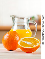 Oranges with a jug of juice