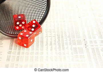 red dice on the financial newspaper