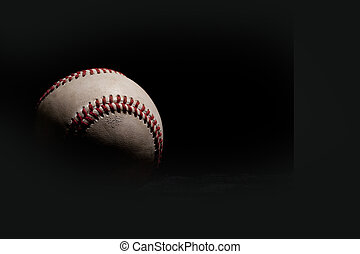 Dark Baseball - Baseball isolated on black background with...
