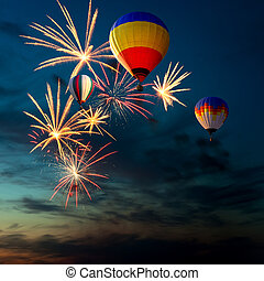 fireworks and hot air-balloon at sunset - bright colorful...