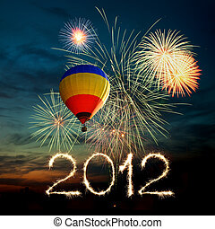 New year 2012 fireworks and hot air balloon at sunset - New...
