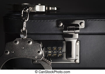 Pair of Handcuffs on Briefcase with 911 on Lock