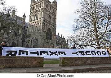 The huge Occupy Exeter banner made for site 2 is unfurled...