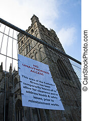 An official warning sign on the emporary fencing - An...