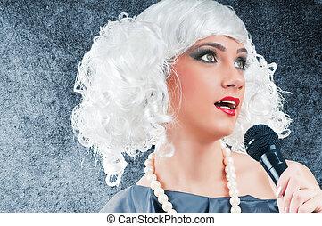 Pop Singer agains grey background