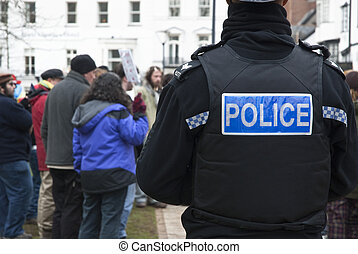 A Devon and Corwall policeman watches the Occupy Exeter...