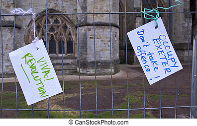 """Two cards reading """" Viva Revolution"""" and """"Occupy Exeter,..."""