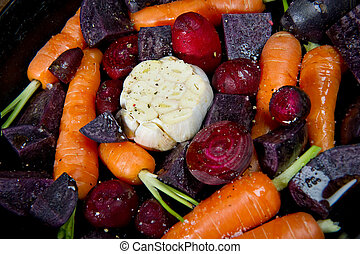 Detail of Raw Root Vegetables - Raw root vegetables in a...