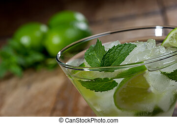 Mojito close up - Fresh mojito in a lowball glass on a...